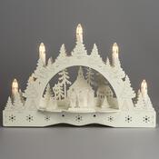 Vánoční LED svícen Zimní krajina, koledníci před kostelem